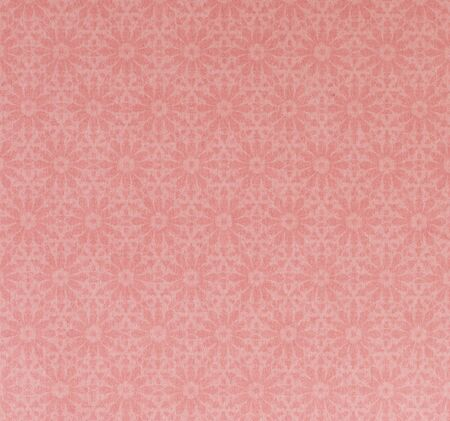 thai pattern on pink textured paper, traditional art photo
