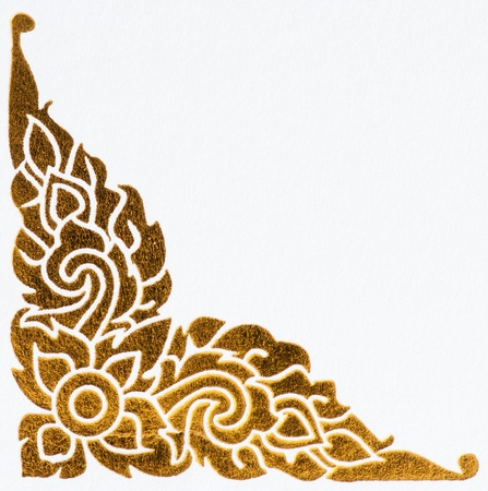 golden thai style pattern on wall, traditional art photo