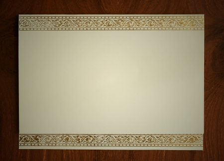 blank card with thai traditional frame on wooden desk photo