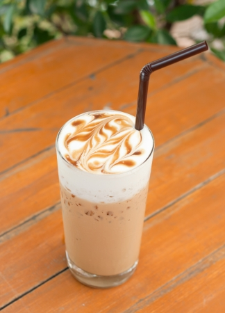 iced latte with latte art photo