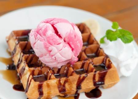 delicious strawberry ice cream with waffle photo