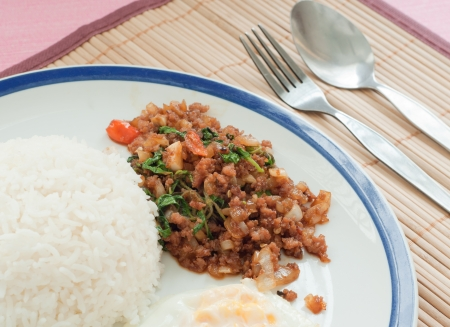 stir-fried pork with holy basil, thai traditional food photo