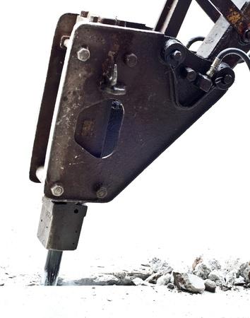 jackhammer, hydraulic arm breaking up isolated on white photo