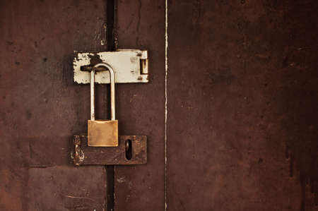 lock on a wooden door background photo