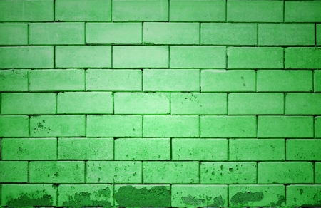 green brick wall getting older from the bottom photo