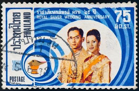 king of thailand: THAILAND - CIRCA 1975: a stamp printed by Thailand, shows Royal silver wedding 25 anniversary, circa 1975 Editorial