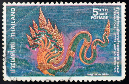THAILAND - CIRCA 1976: a stamp printed by Thailand, shows Naga, circa 1976 photo