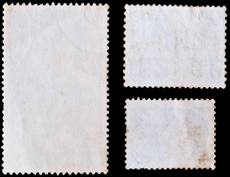 blank postage stamps isolated on black photo