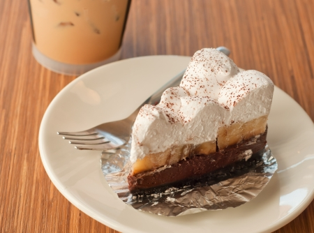 cream pie: pie cake with banana and chocolate in coffee shop