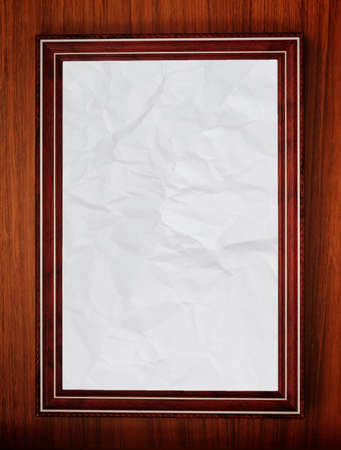 wooden frame with blank creased paper photo