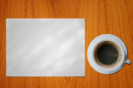 blank paper with coffee cup on wood table photo