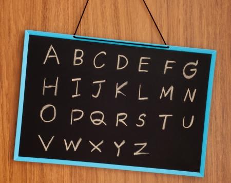 english language: hand drawing alphabet on chalkboard