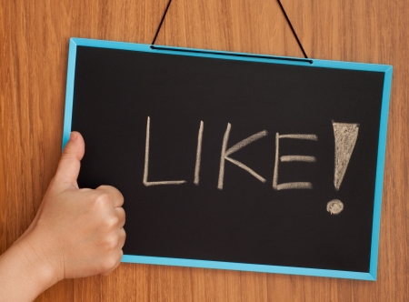 like word on chalkboard with hand like concept Stock Photo - 17984533
