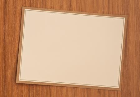 blank invitation card on wood table photo