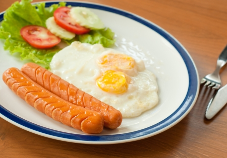 fried eggs with hotdog, breakfast photo