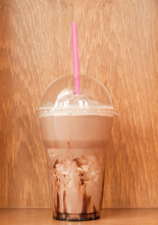 take away: chocolate frappe on wood table Stock Photo