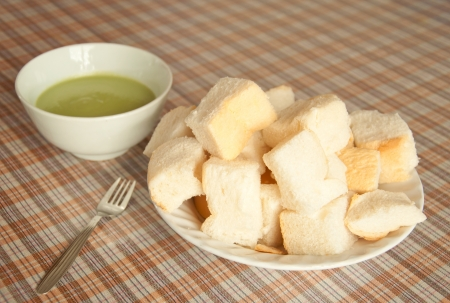 piece of bread with green egg custard, thai style snack photo