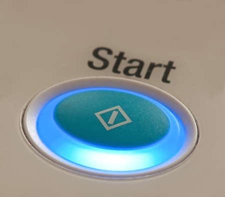 start button on computer device photo