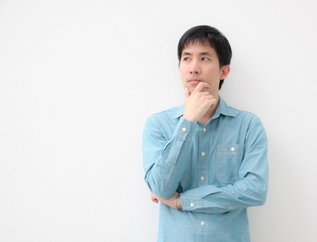 confused person: portrait of an asian man thinking