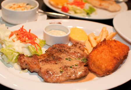 beef steak with fish fried photo