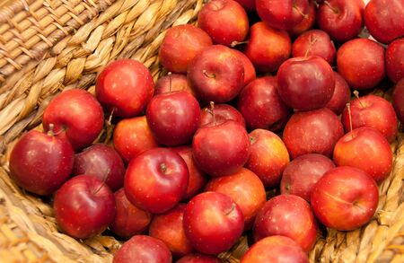 apples in basket for sale photo