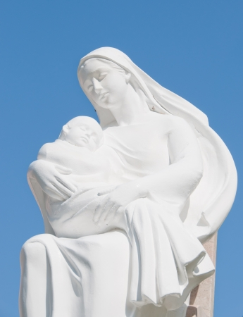 homily: statues of holy women with blue sky