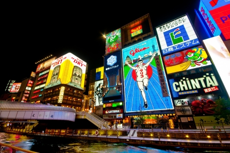 osaka: OSAKA, JAPAN - Jun 9: The Glico Man Running billboard on June 9, 2013 in Dotonbori, Osaka, Japan. Dotonbori is one of famous place in Japan.