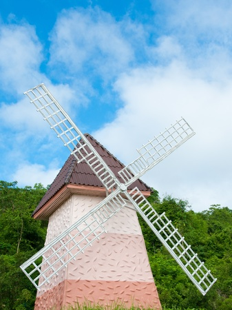 small windmill with blue sky photo
