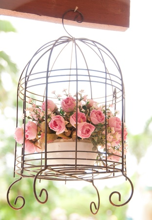 vintage wedding decorative birdcage with flowers photo