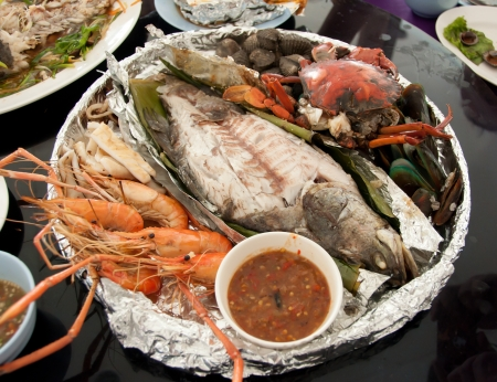 grilled seafood on restaurant table photo