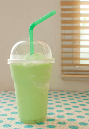 juice bar: green apple smoothie on table