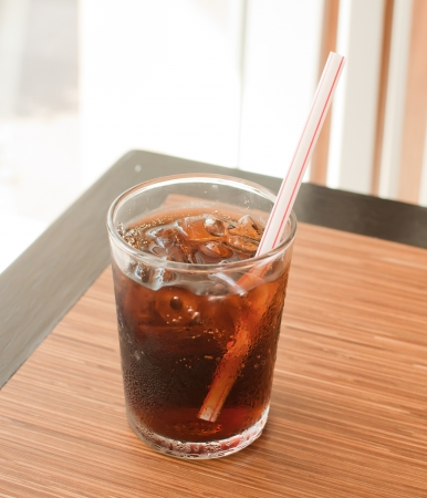 carbonated: cola with ice on cafe table Stock Photo