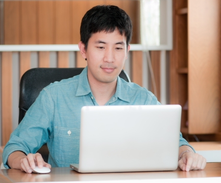 e work: asian man working with laptop