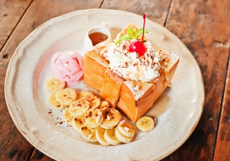 delicious honey toast with strawberry ice cream photo