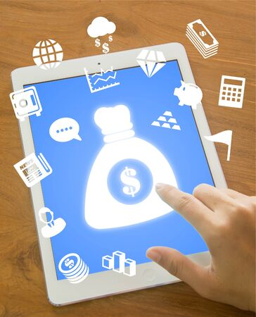 touching money bag icon on tablet