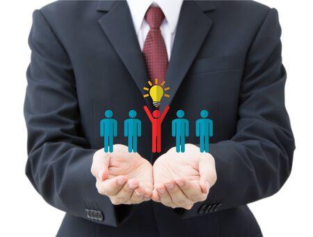 business man holding human resource management icons Фото со стока