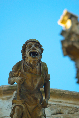 architectural architectonic: A gargoile on the gothic Saint Barbara Cathedral in town of Kutna Hora, Bohemia