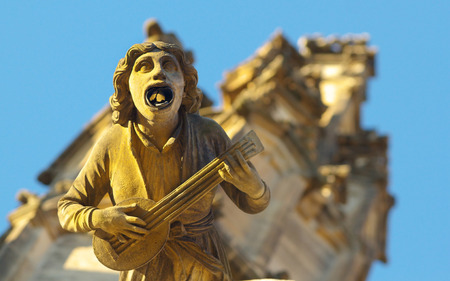 architectural architectonic: A statue of musician on the gothic Saint Barbara Cathedral in town of Kutna Hora, Bohemia