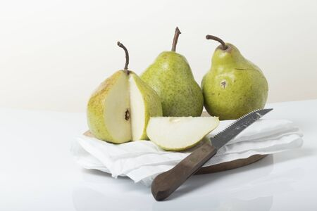 Still life of pears. The pear is a juicy, fleshy fruit perfect for making brandy. It is one of the least allergies to humans and has more than 80% water content.