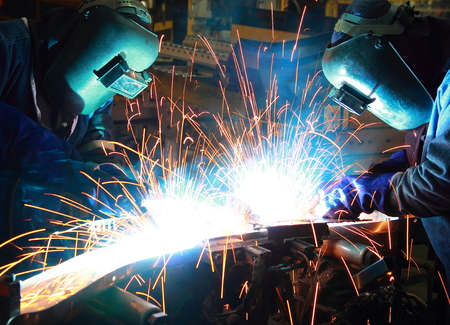 Teamwork in Welder Geschick up Lizenzfreie Bilder