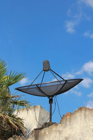 telecast: Satellite dish with sky on roof