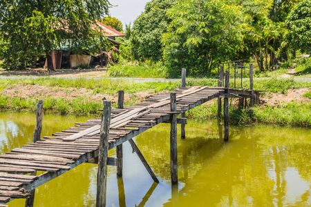 footpath: wooden foot bridge over a small river Stock Photo
