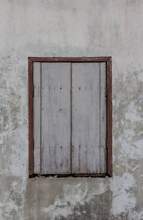 hinges: Old weathered wooden window with hinges