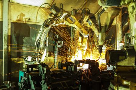 welding machine: robots welding in a car factory