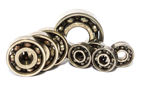 chock: Old and dirty ball bearing, isolated on white background Stock Photo