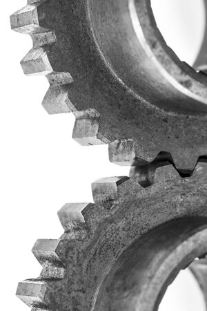 linked: Heavy metal gears linked together on white background. Stock Photo