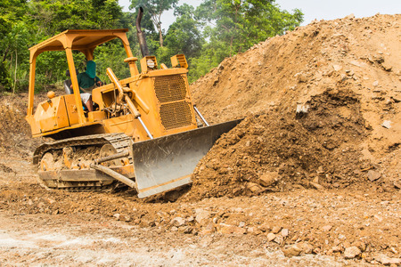 sand pit: industrial bulldozer moving earth and sand in sand pit or quarry