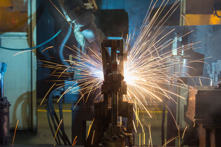 assembly line: The movement of the welding robot in a car factory Stock Photo