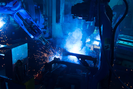 The movement of the welding robot in a car factory Stock Photo - 44630147