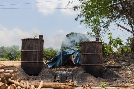 incinerator: Charcoal incinerator in the field of countryside. Stock Photo